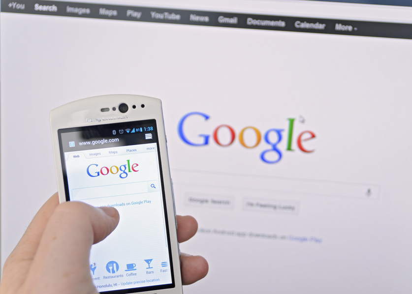 a smartphone and computer running google search.